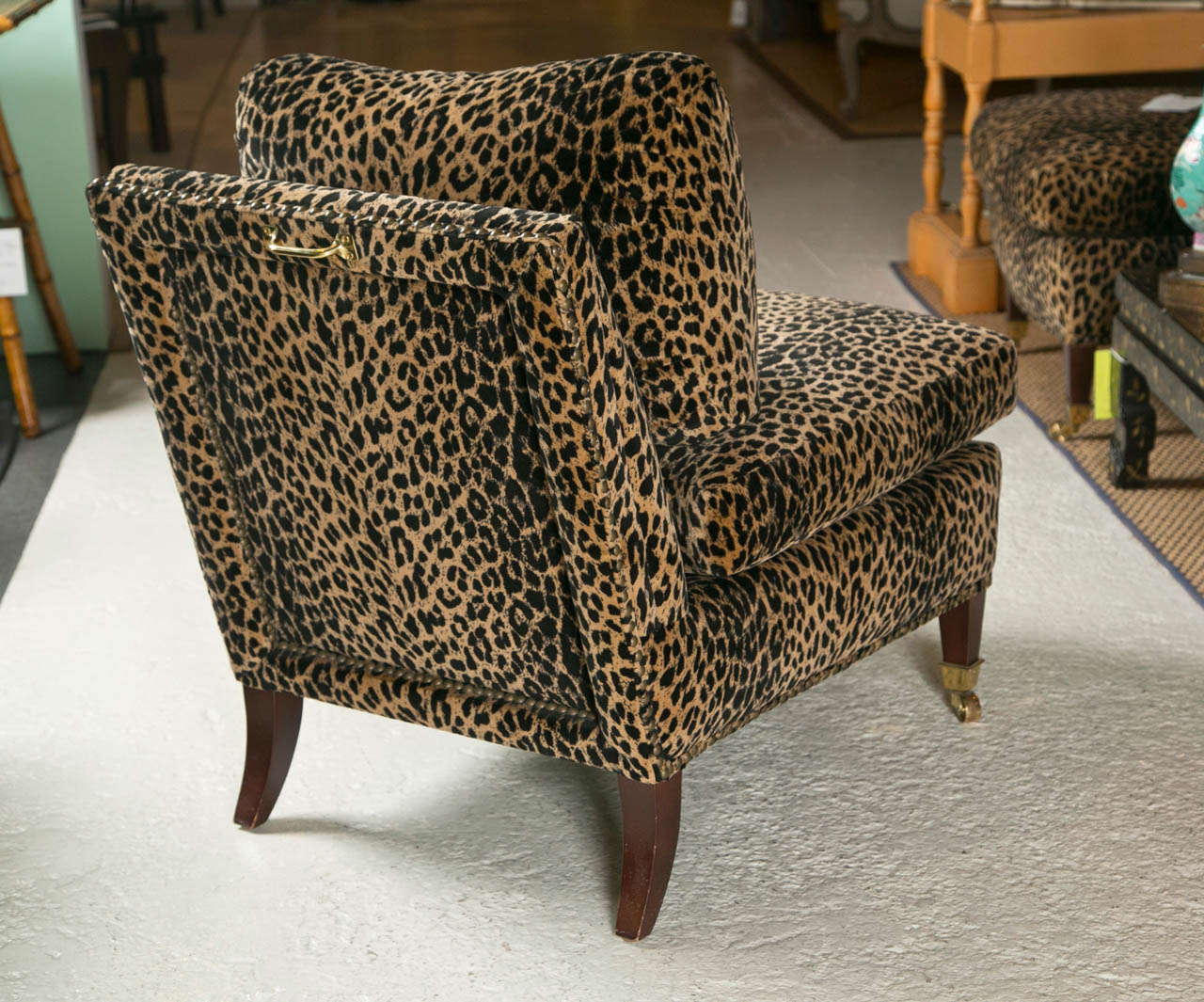 leopard print sofa appears spa collection chenille bed mid century lolling chairs upholstered in animal