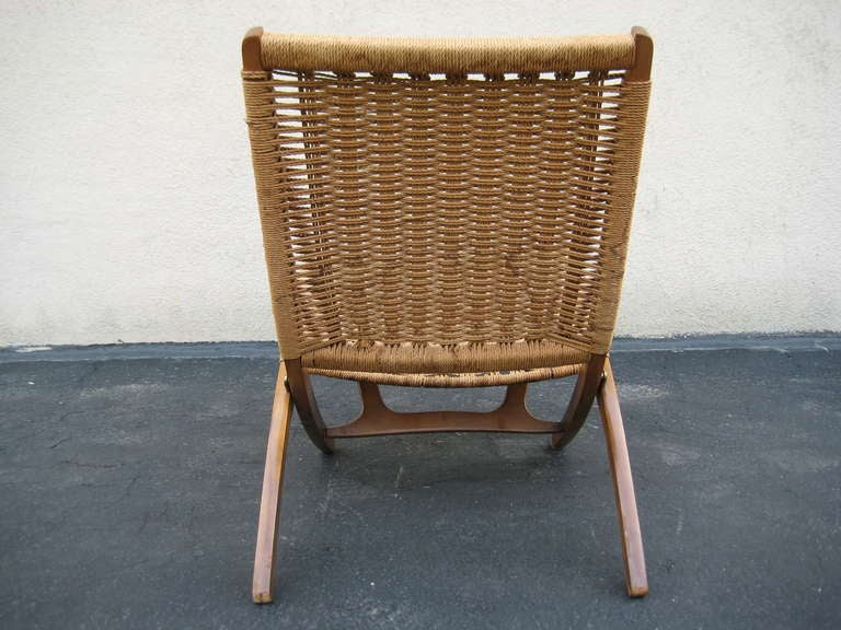 folding wicker chairs chair with side table woven in the style of hans wegner at 1stdibs