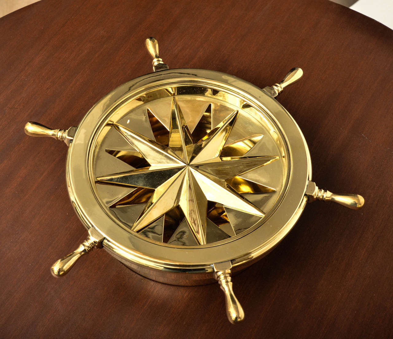 revolving chair without wheels 2 dining table nautical themed brass ash tray with rotating ship wheel
