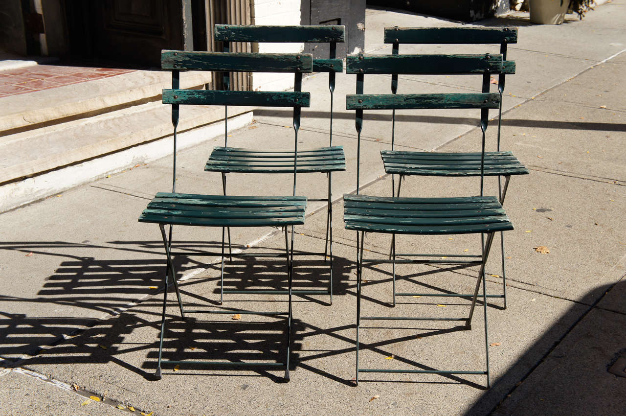 green french bistro chairs staples desks and a set of four vintage folding at 1stdibs