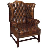 Antique English brown leather wing chair. at 1stdibs