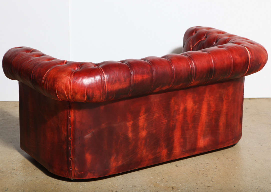 red leather sleeper sofa wrought iron set bangalore 2 mahogany chesterfield and
