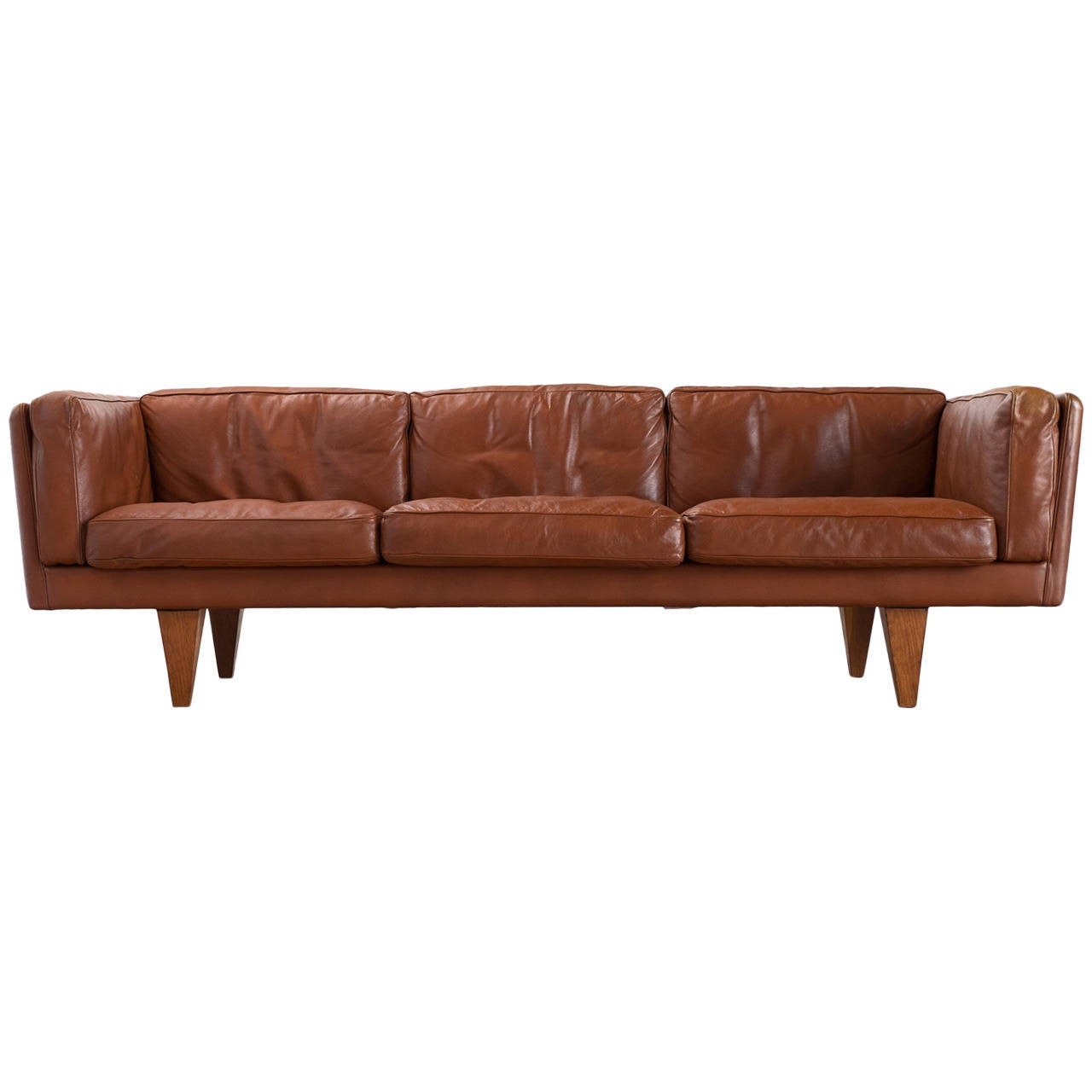 down filled leather sectional sofa light blue recliner illum wikkelsø three seat in brown and