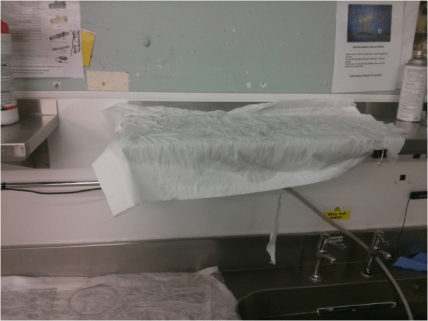 Image of the sink shelf drying area for manually-washed items, post-manual wash process.