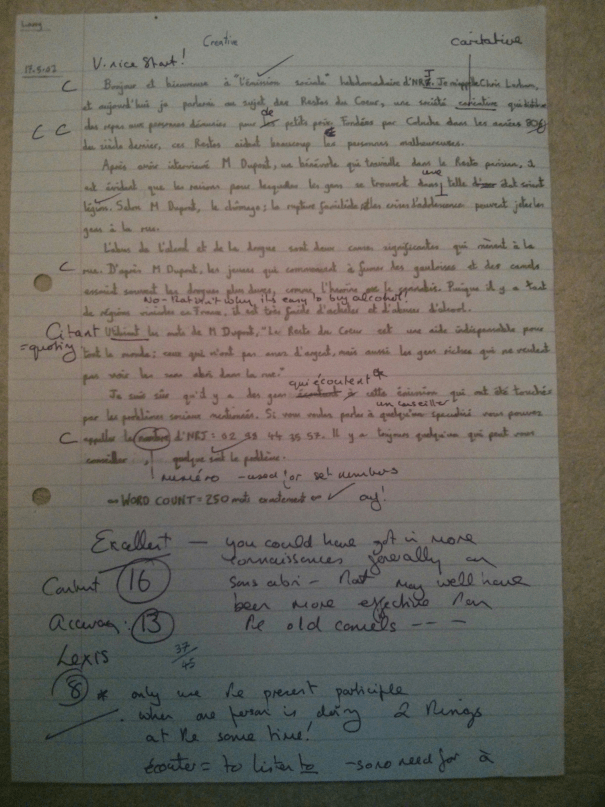 An image of Chris Larham's piece of French A Level creative writing in the form of a radio broadcast transcript on the topic of 'Restos du Coeur' [37 out of 45, 2001/2002].