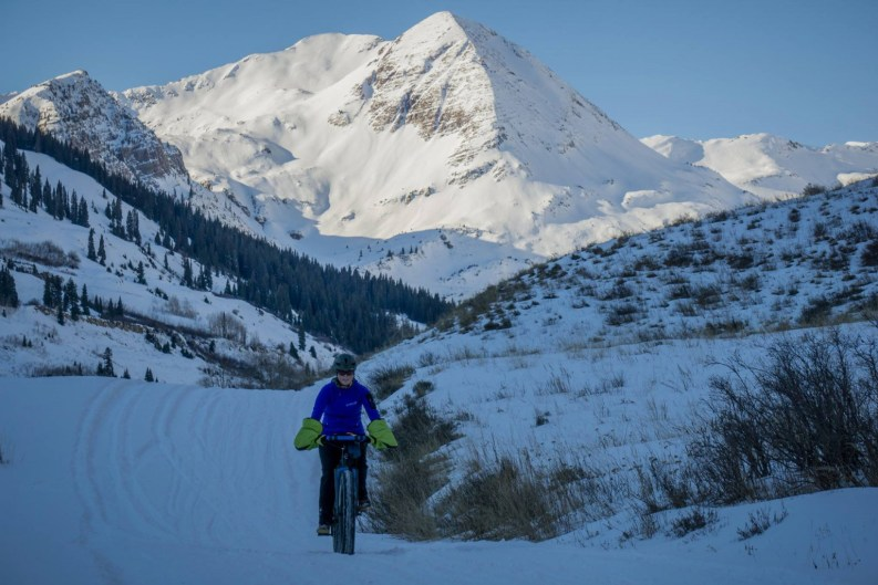 Fat biking on the Slate River Road in winter is fun!  Photo courtesy of Gunnison-Crested Butte Fat Bikers.