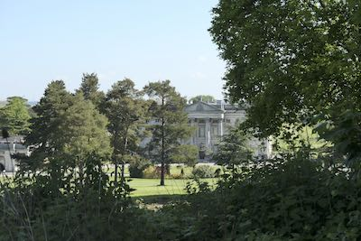 Moor Park Mansion through the trees