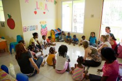 Singing & playing games with the children.