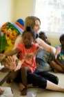 Founder, Tabea, playing with the children