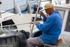 Fisherman mending his nets, Rovinj, Croatia