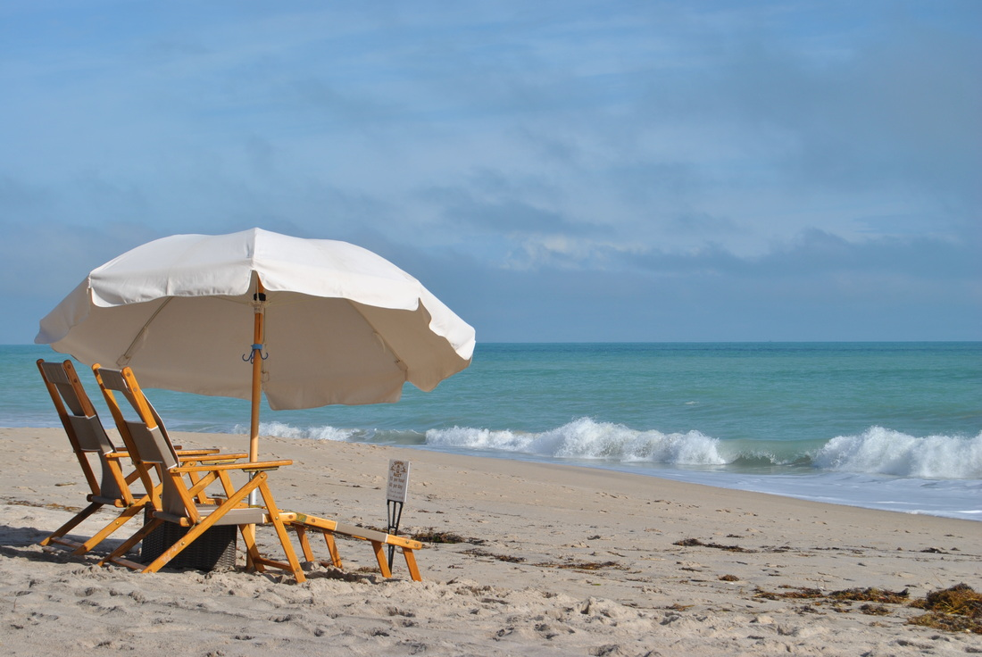 Beach Chairs With Umbrella On The Beach Beach Umbrellas Chairs Games And Other Beach Gear