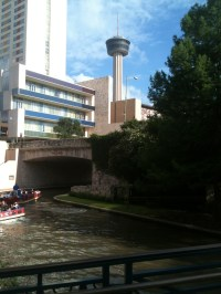 I took this photo from a pedestrian bridge on the River Walk. The Tower of the Americas is in the background.