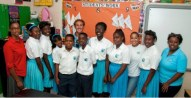 Smile for the Reefs - Students at H.O. Nash Junior High are all smiles after watching a lively presentation of shark births, migrating patterns and photos of rare species, part of an education and research program sponsored by Moore Bahamas Foundation and BREEF.