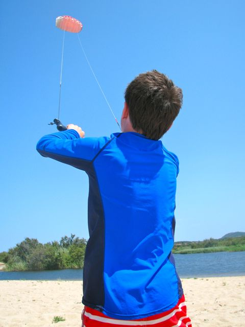 Sol gets his first lesson in flying a kite.