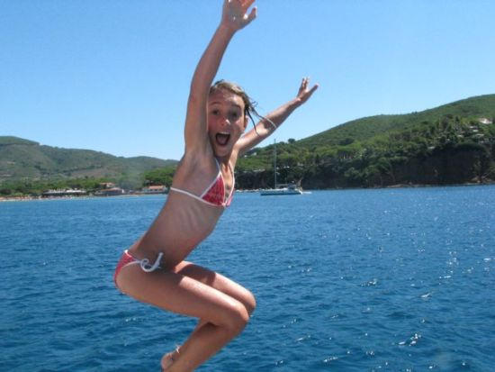 Leonie jumping off the boat