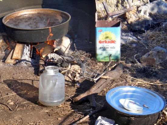 Carob Cidre cooking for 24 hours over open fire in Kale Köy