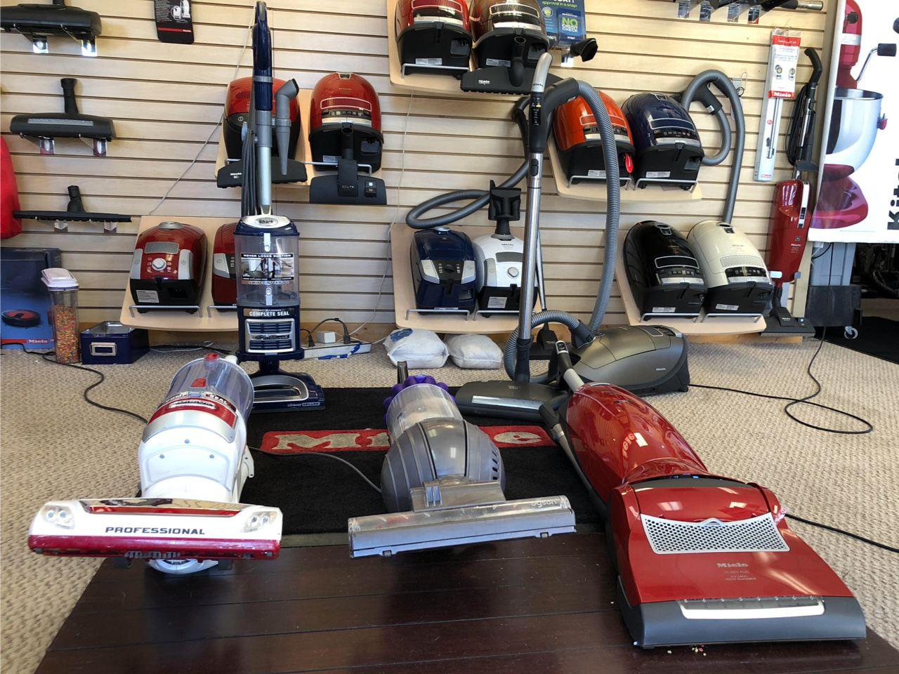 compare Miele, Dyson, and Shark vacuums