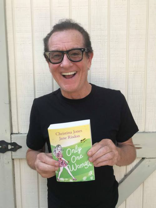 Musician Graham Bonnet holding a copy of Only One Woman