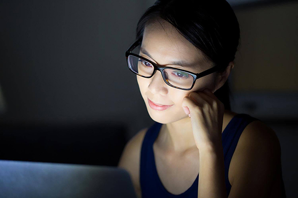 Computer screen producing glow on woman's face