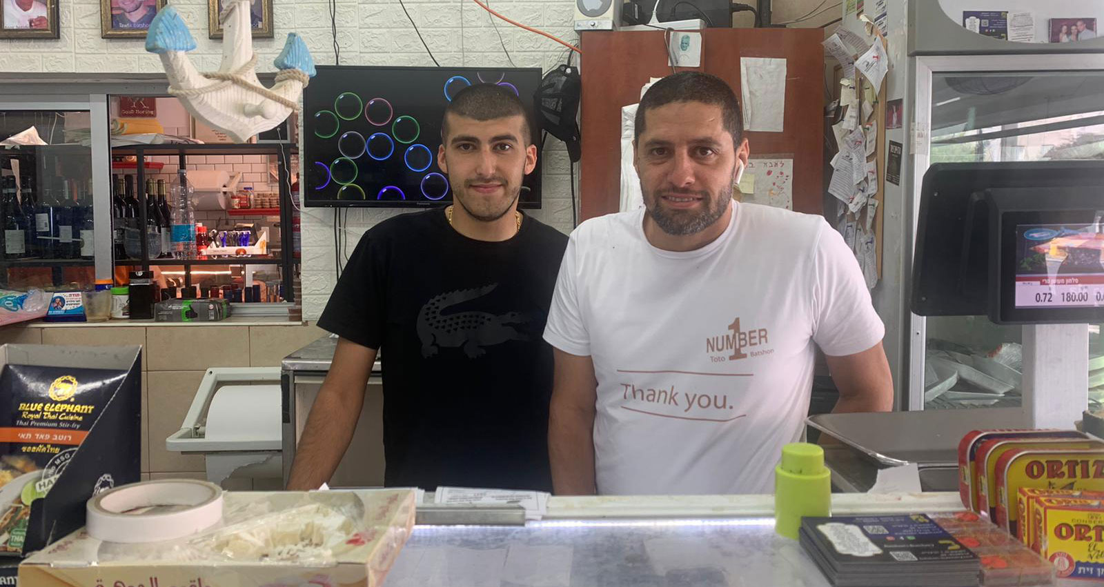 בעל החנות והמותקף טוטו בטשון ועיסא סורי
