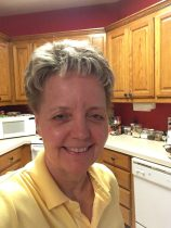 sharon outlaw hillam in yellow shirt, selfie in the kitchen