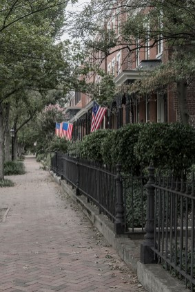 Flags hanging from row houses in a small neighborhood of Richmond, Va.