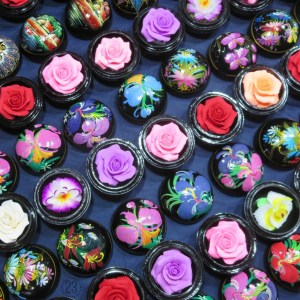 Soaps carved into delicate flowers in the Chiang Mai market (Thailand). Booth after booth of handcrafted goods line the streets. Have baht? Silk scarves, wood carvings, jade jewelry, t-shirts and more are all here!