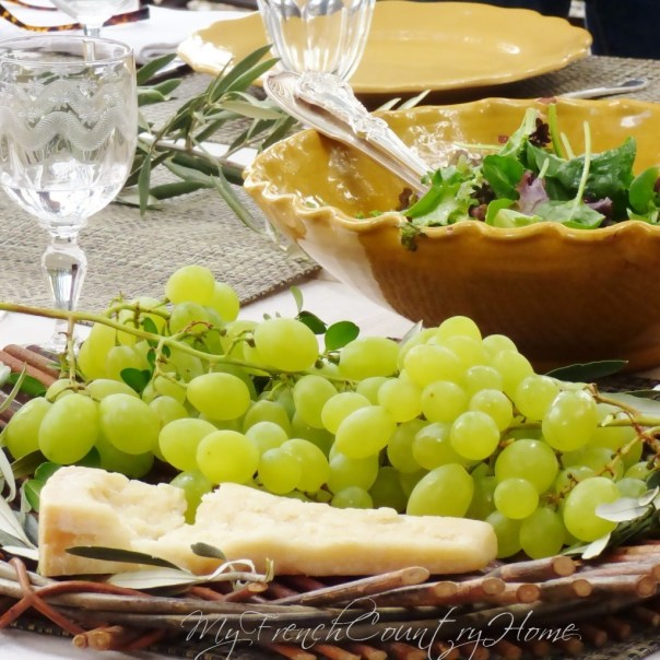cheese and grapes at the end of the meal