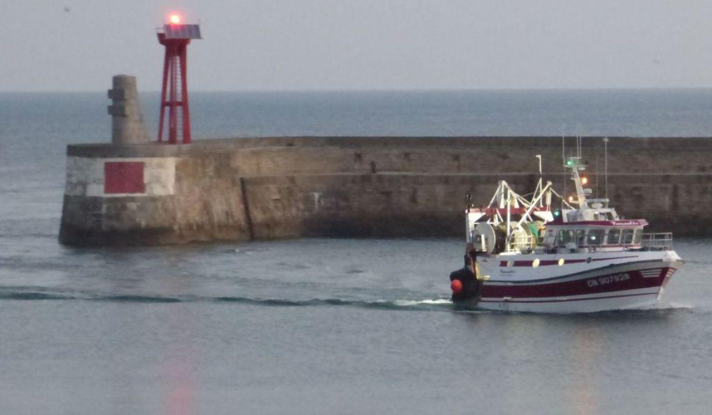 fishing boat coming into harbor