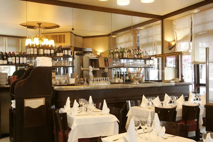 typical bistrot seating at chez andré in paris