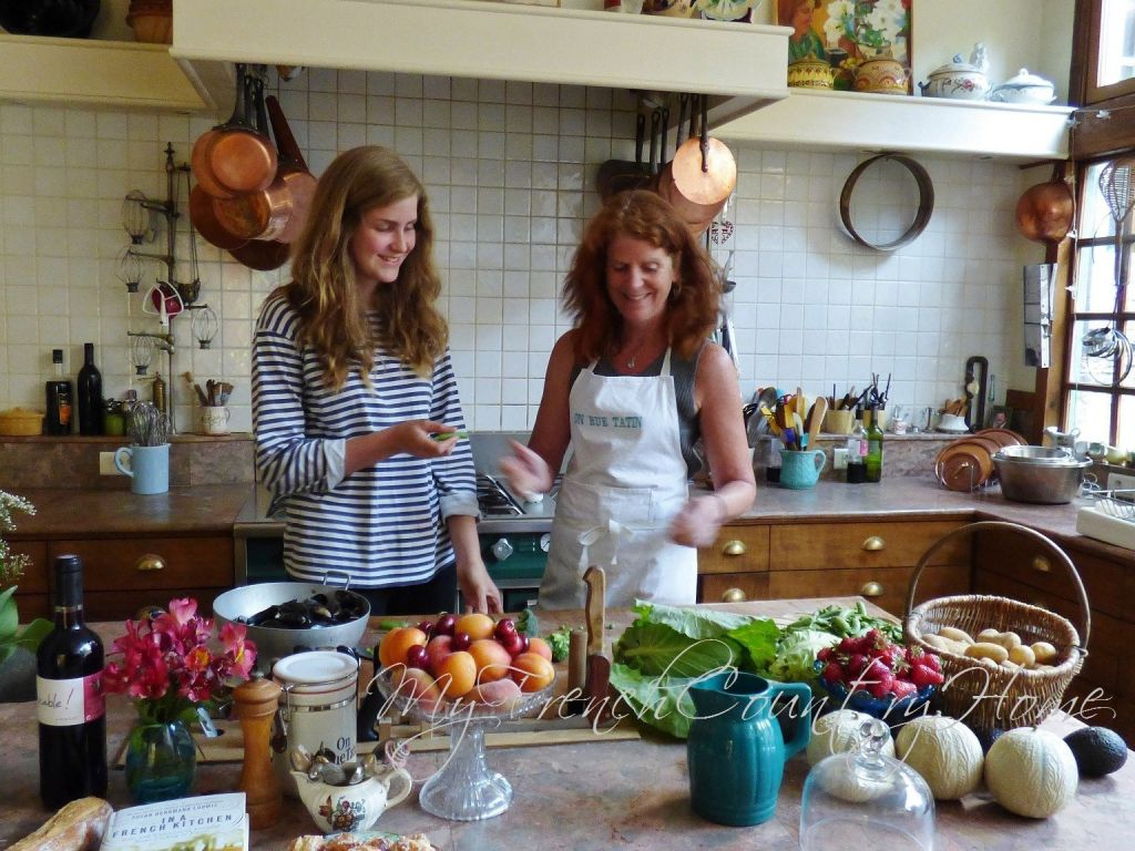 two women in a french kitchen