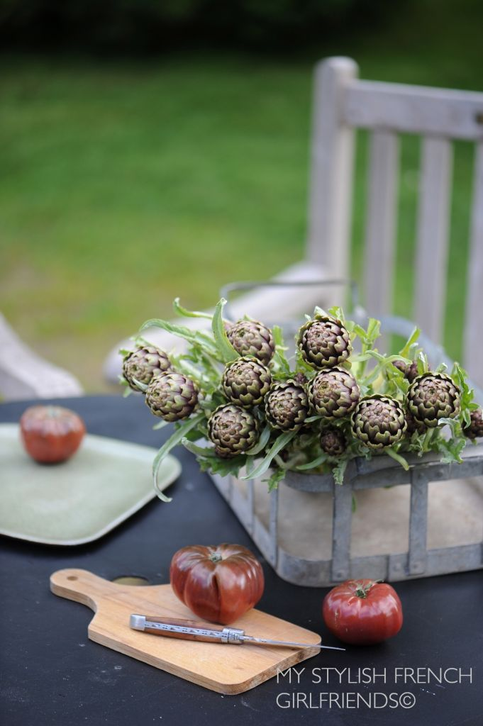 artichokes and tomatoes on table