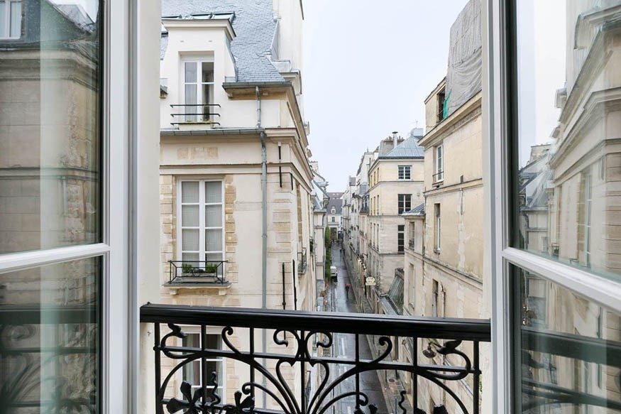 view out of a window onto a paris street