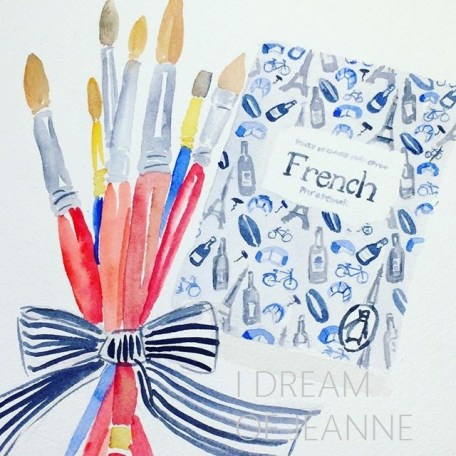 watercolour of paintbrushes and book