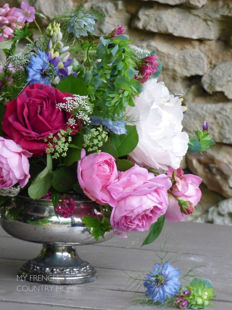 roses and peonies in silver vase