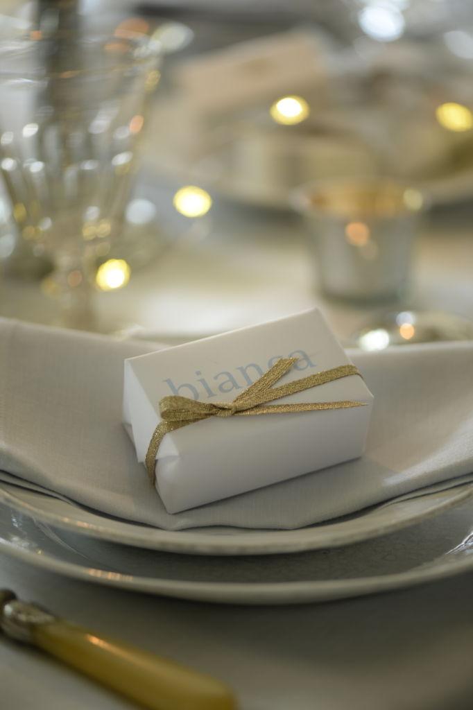 gift on plate at christmas table