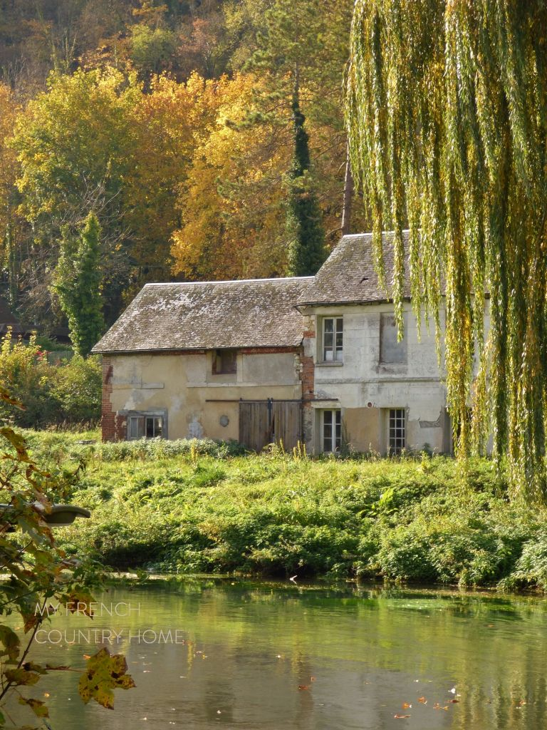 house by river in normandy