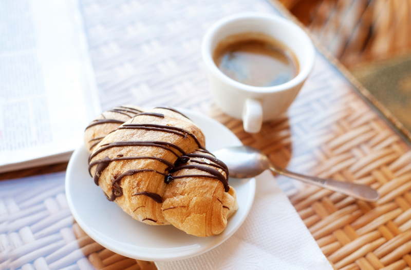 coffee with pastry and newspaper