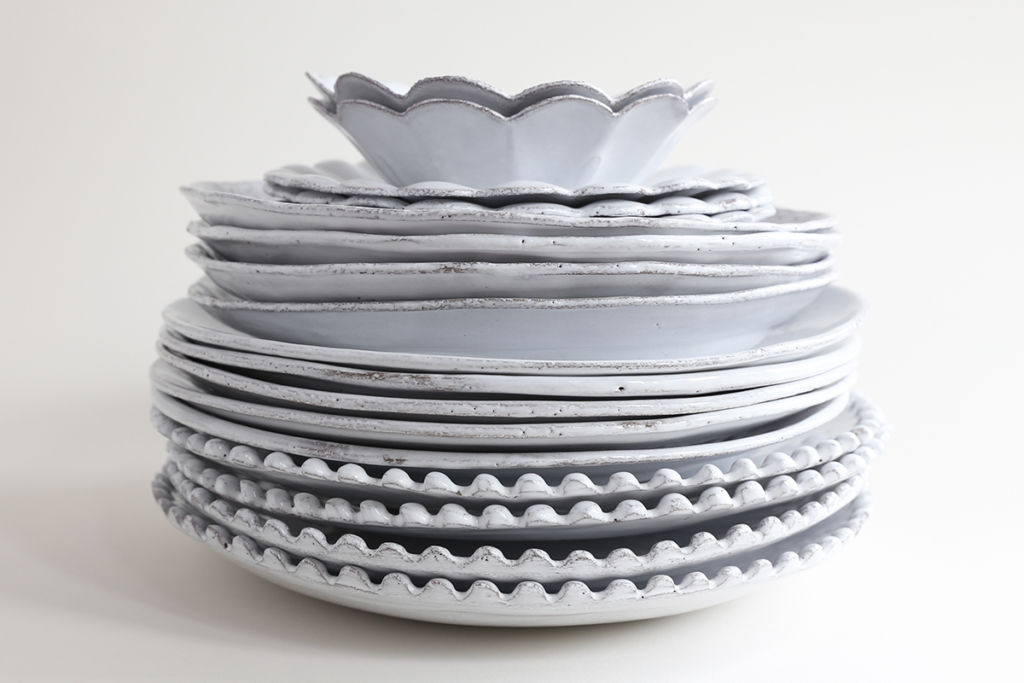 white plates in pile