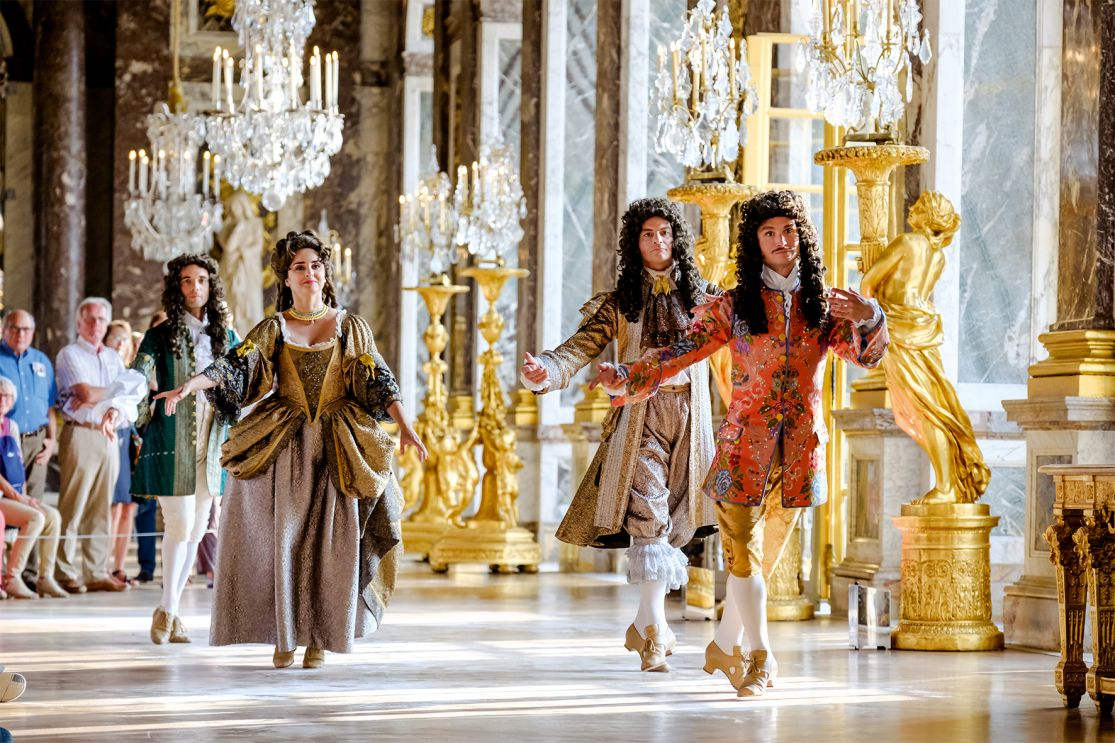Dancers in the Hall of Mirrors at the Versailles Palace