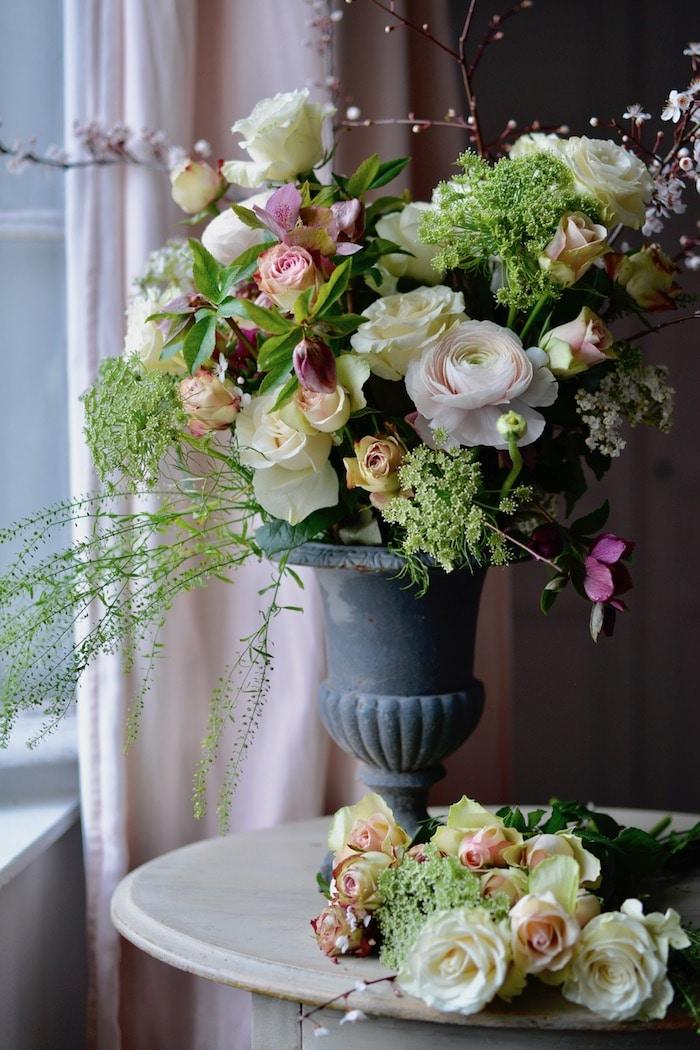 bouquet of flowers by a window