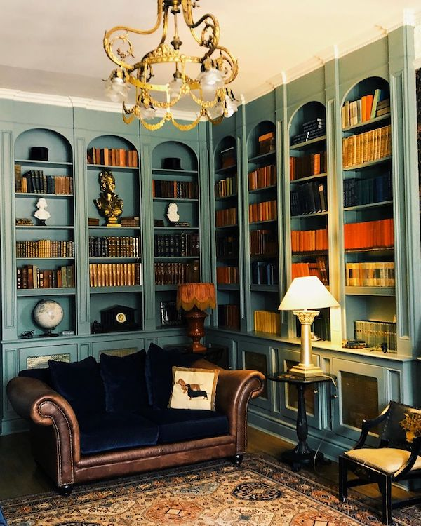 library with blue couch and blue walls