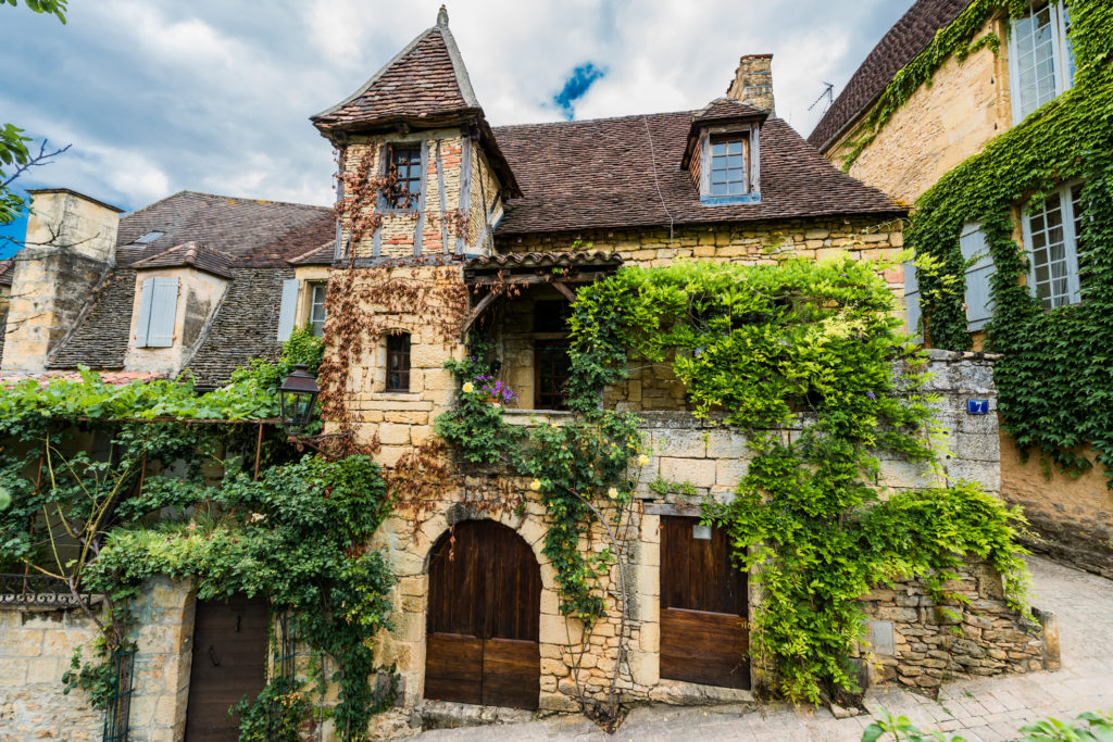ivy covered house in dordogne france