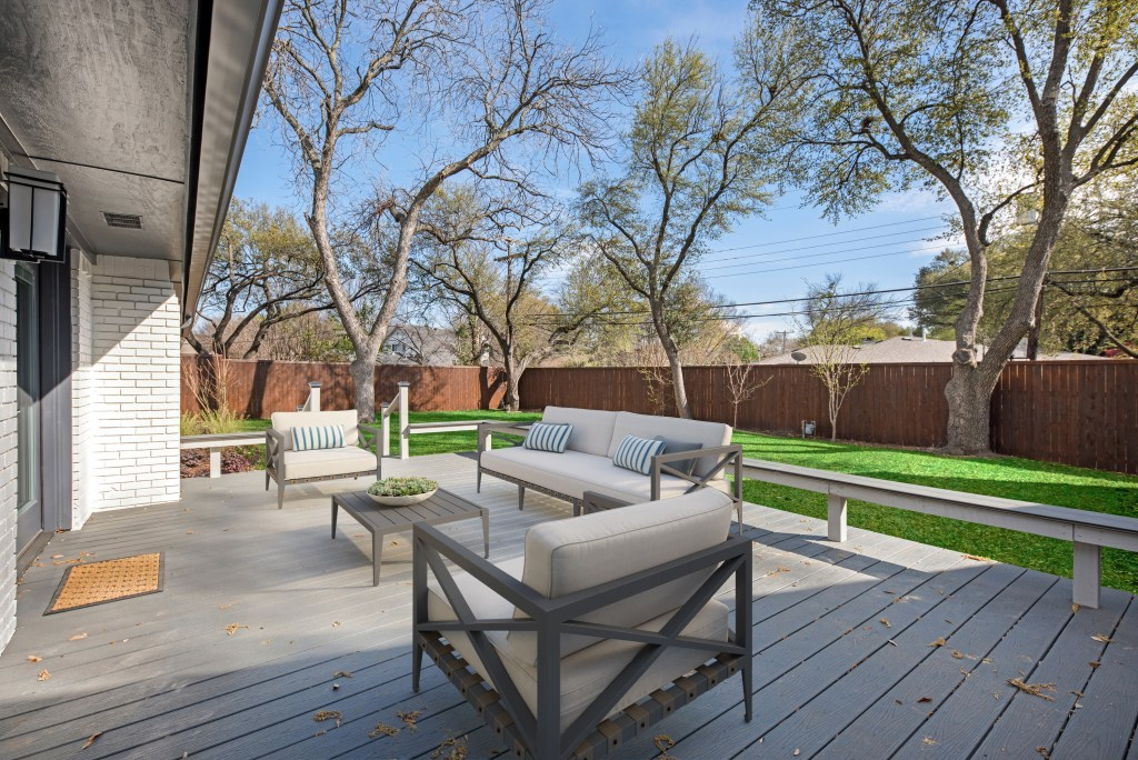 real estate photography of wood deck and patio area