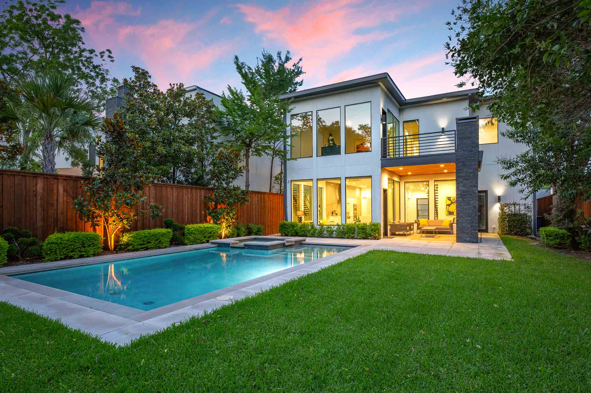 Twilight photo of pool in Dallas home for sale