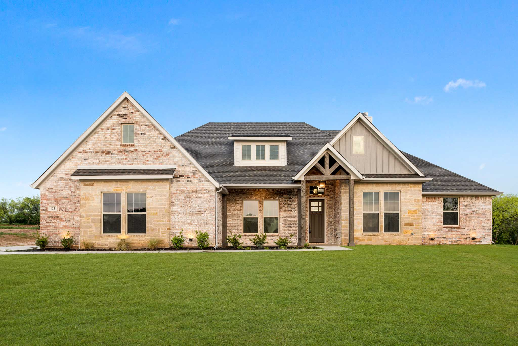 Front exterior home photo with green grass