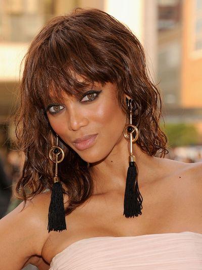 tyra banks earrings black long