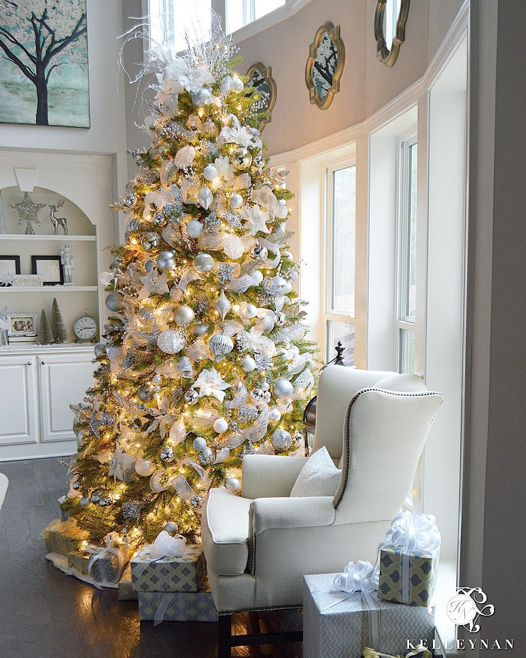 Best 9 Foot White Gold And Silver Christmas Tree Filled With Ornaments In Two Story Great Room In This Month