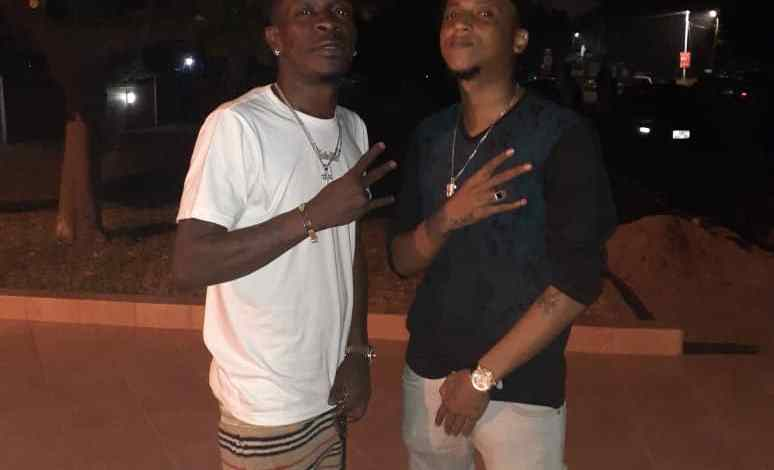 Photo of ARA-B AND SHATTA WALE SPOTTED HAVING FUN TOGETHER THROWING MONEY ON THE STREETS
