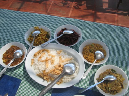The typical Sri Lankan rice and curry lunch consists of 5 curries. These curries are (from left to right) pumpkin, banana flower, beet root , lentil and okra.